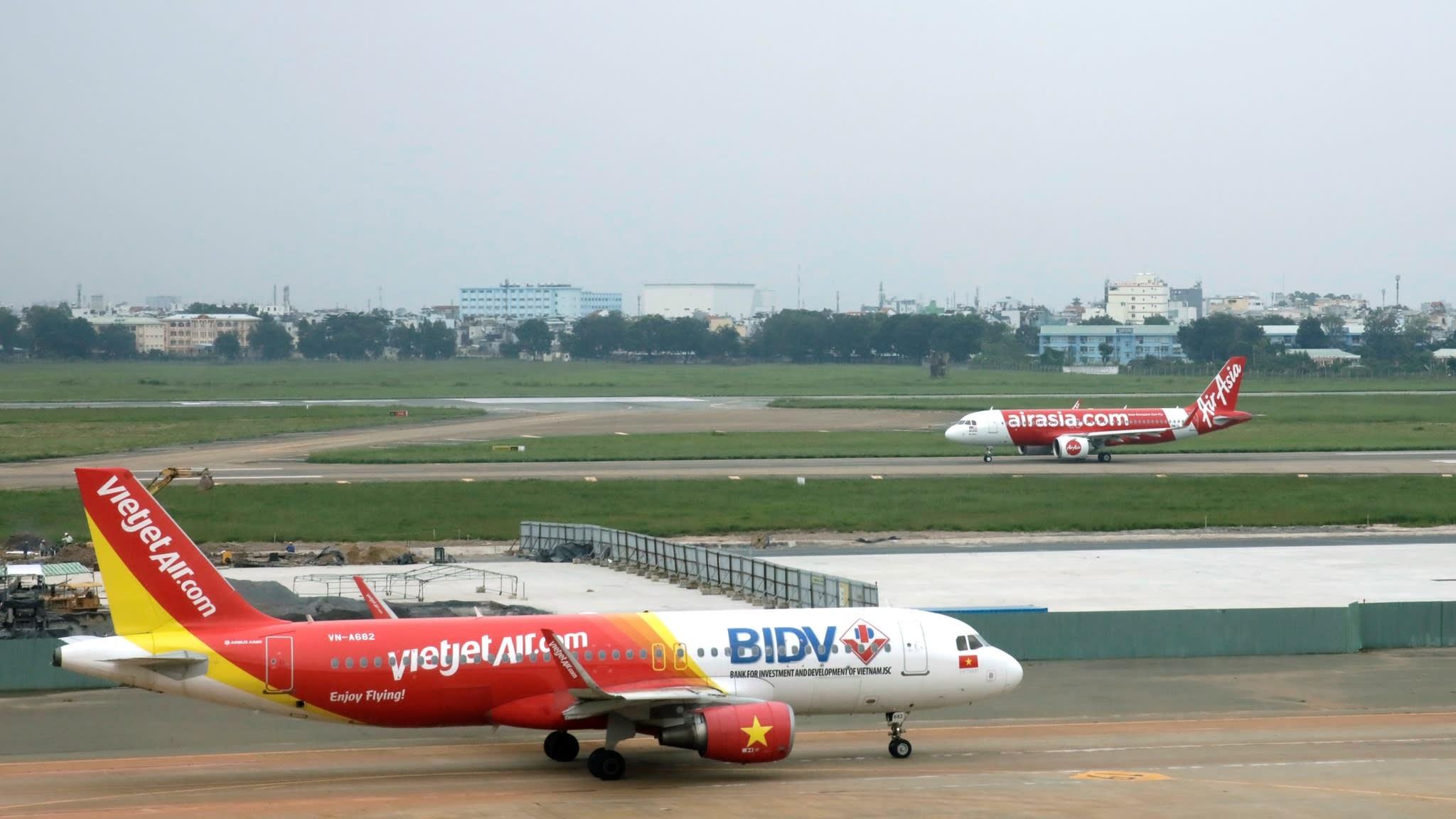 AirAsia vs Vietjet - cuoc doi dau ky phung dich thu tai Viet Nam hinh anh 1