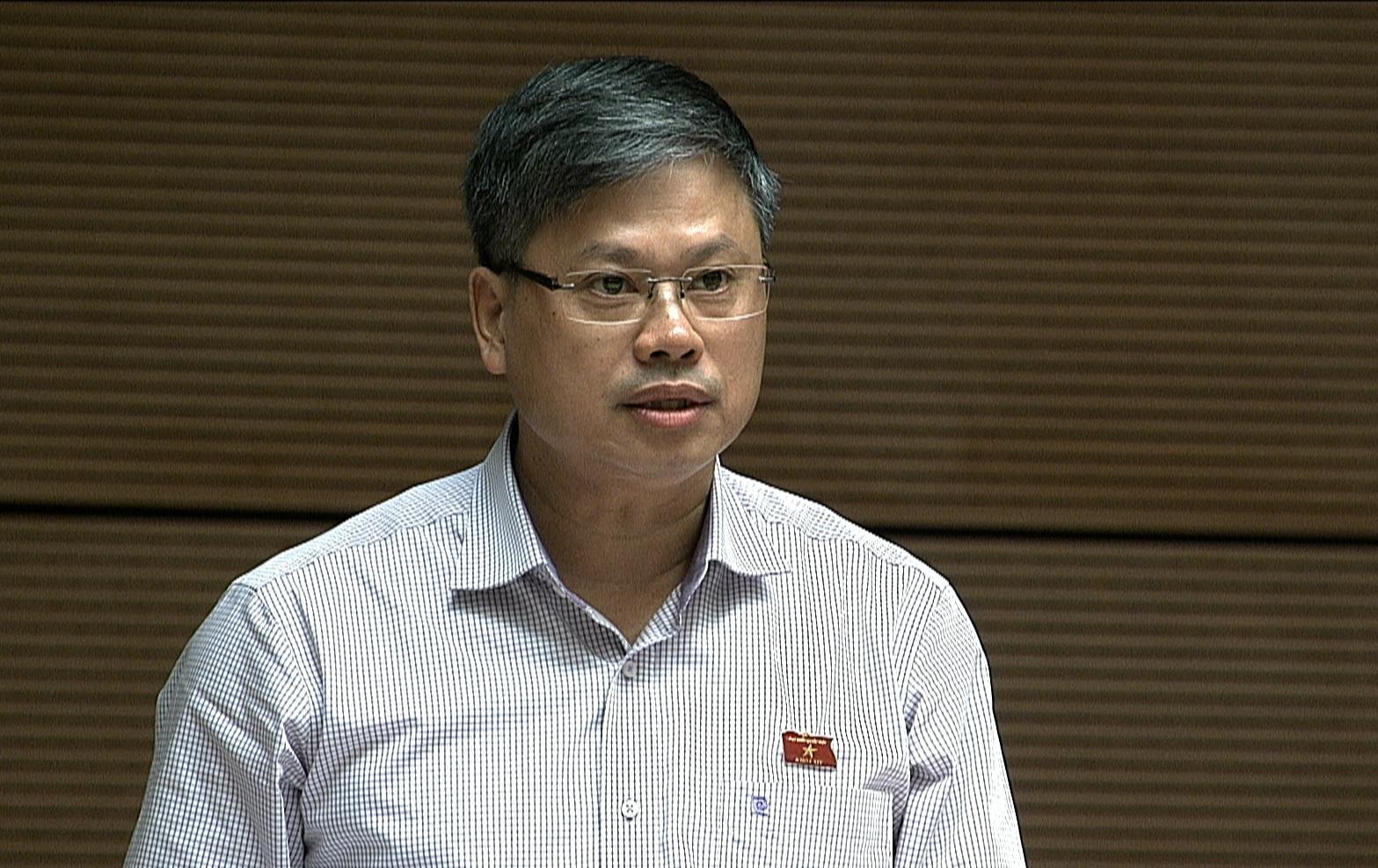Bo truong Tai chinh dang tra loi chat van Quoc hoi anh 10