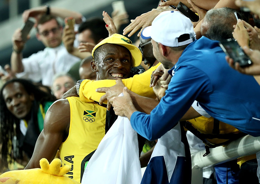 Usain Bolt hanh phuc trong vong tay CDV anh 4