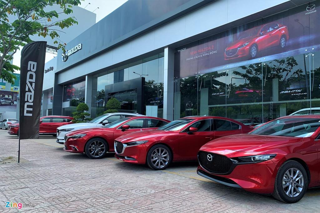 Khach dung mua xe, cho giam 50% phi truoc ba oto lap rap hinh anh 3 Mazda_Zing.jpg