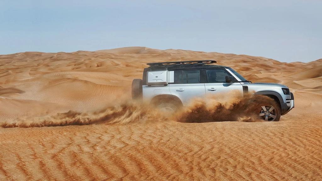 Land Rover Defender moi va cu anh 12