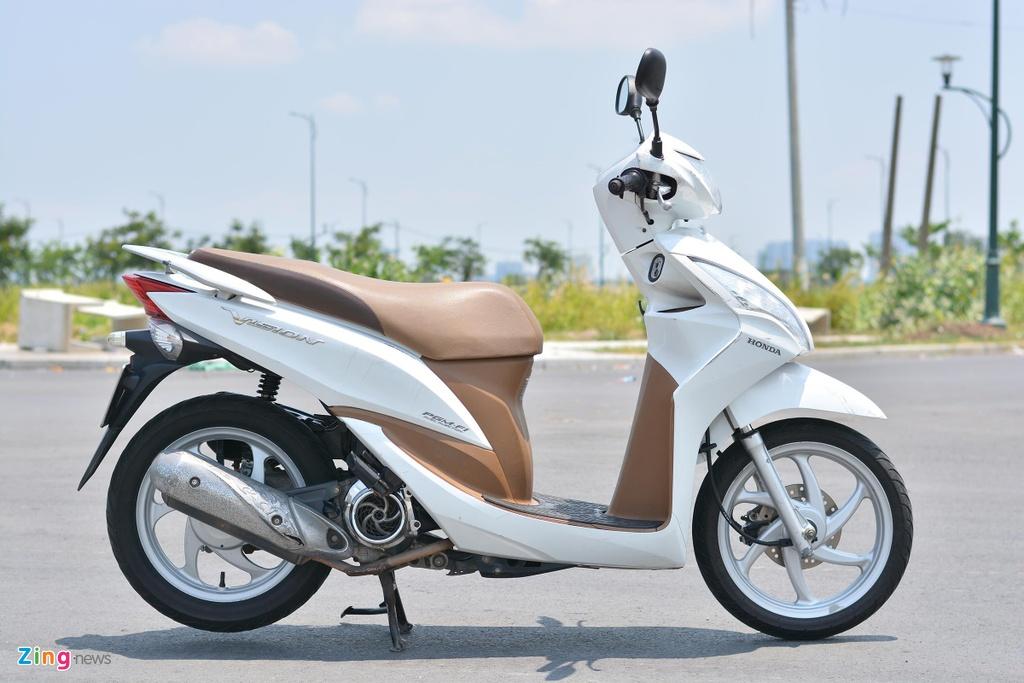 Honda Vision hay Yamaha Janus anh 1