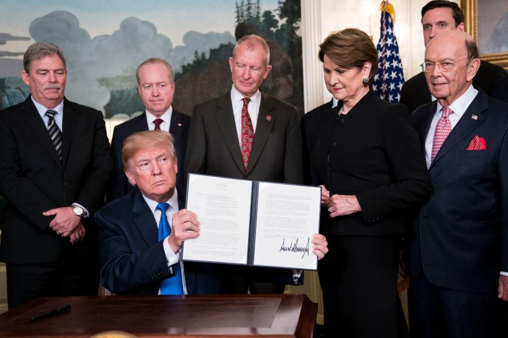Trump huy hoai WTO anh 1