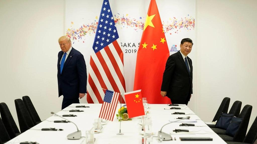Ra lenh cong ty My roi Trung Quoc, TT Trump khong chi doa suong hinh anh 1