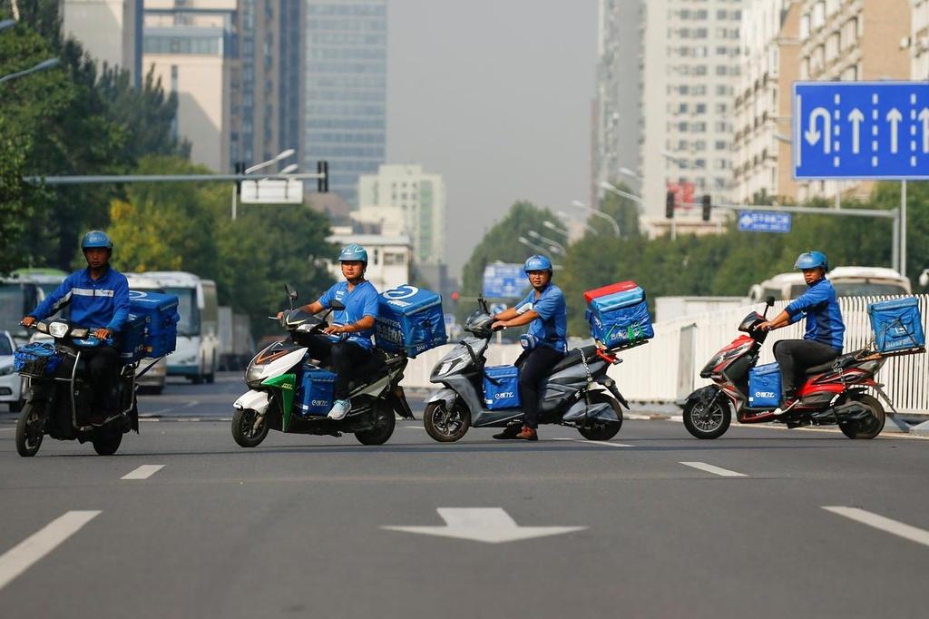 Tai xe giao do an TQ lieu mang song de lam giau cho Alibaba va Tencent hinh anh 5