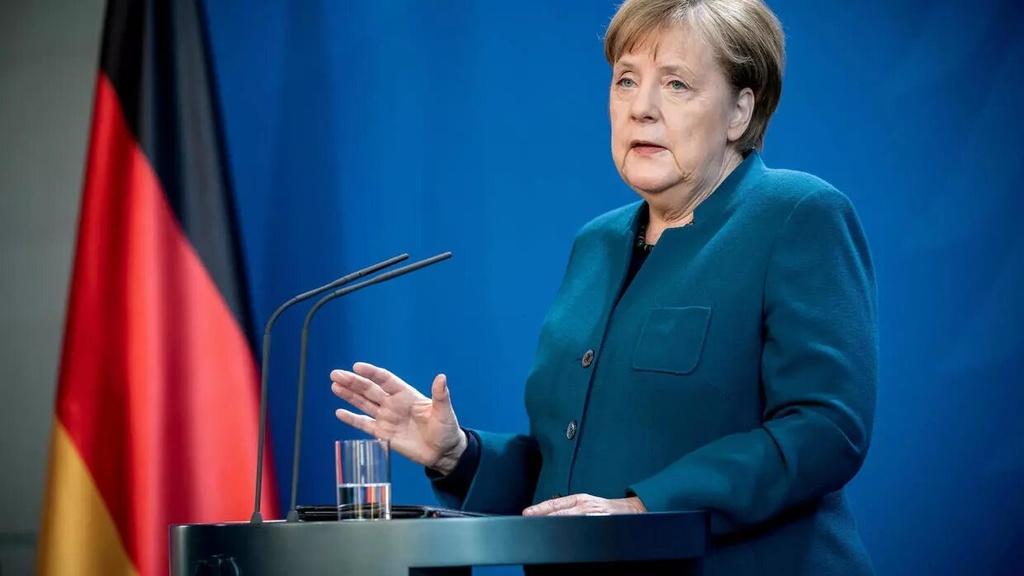 Chuyen gia Duc tran tro voi 'nghich ly chong dich' hinh anh 6 Merkel_Pool.jpg