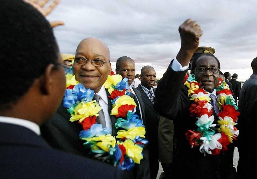 Tong thong Zimbabwe Mugabe: 37 nam cam quyen va 2 doi vo hinh anh 10
