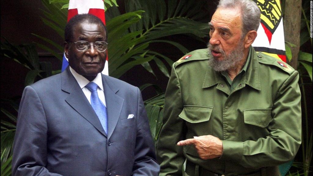 Tong thong Zimbabwe Mugabe: 37 nam cam quyen va 2 doi vo hinh anh 9