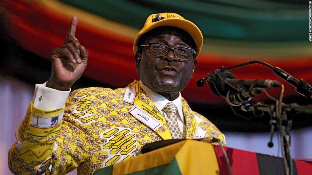 Tong thong Zimbabwe Mugabe: 37 nam cam quyen va 2 doi vo hinh anh 11