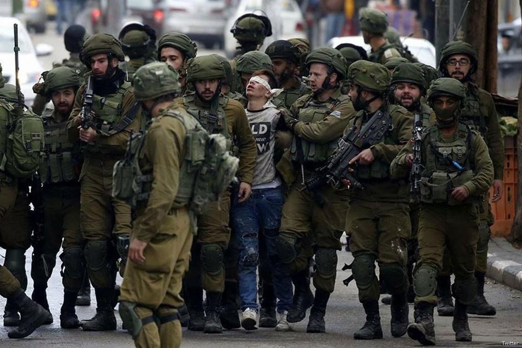 Mat vu Israel manh tay tran ap, bat giu 200 nguoi Palestine hinh anh 1