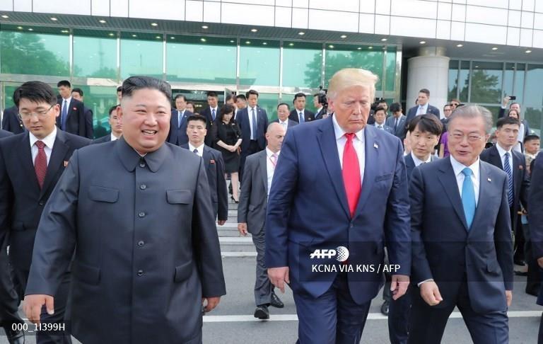 Truyen thong Trieu Tien 'phat cuong' voi cuoc gap Trump - Kim hinh anh 10