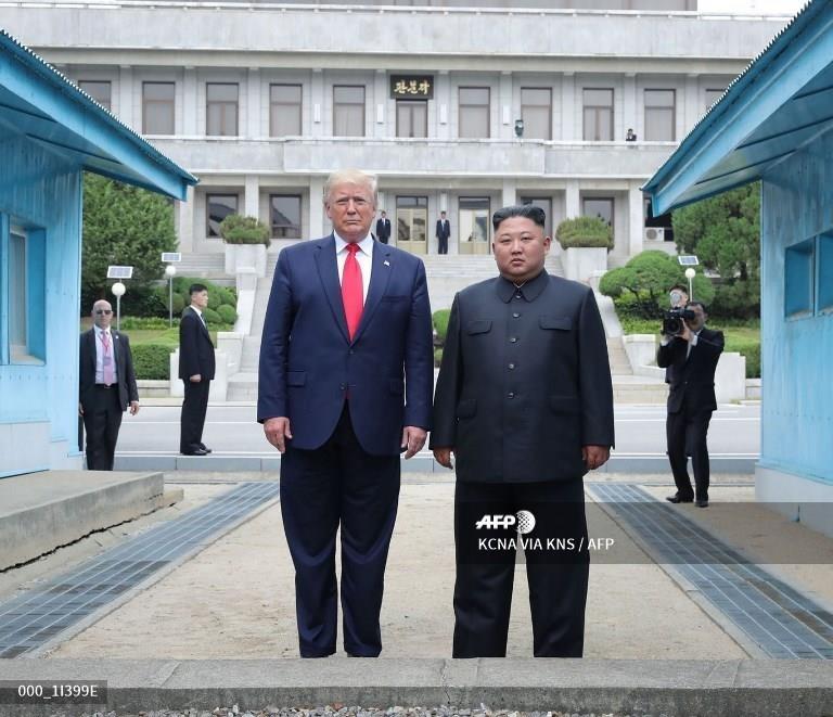 Truyen thong Trieu Tien 'phat cuong' voi cuoc gap Trump - Kim hinh anh 2