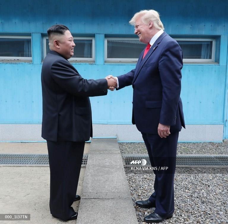 Truyen thong Trieu Tien 'phat cuong' voi cuoc gap Trump - Kim hinh anh 7