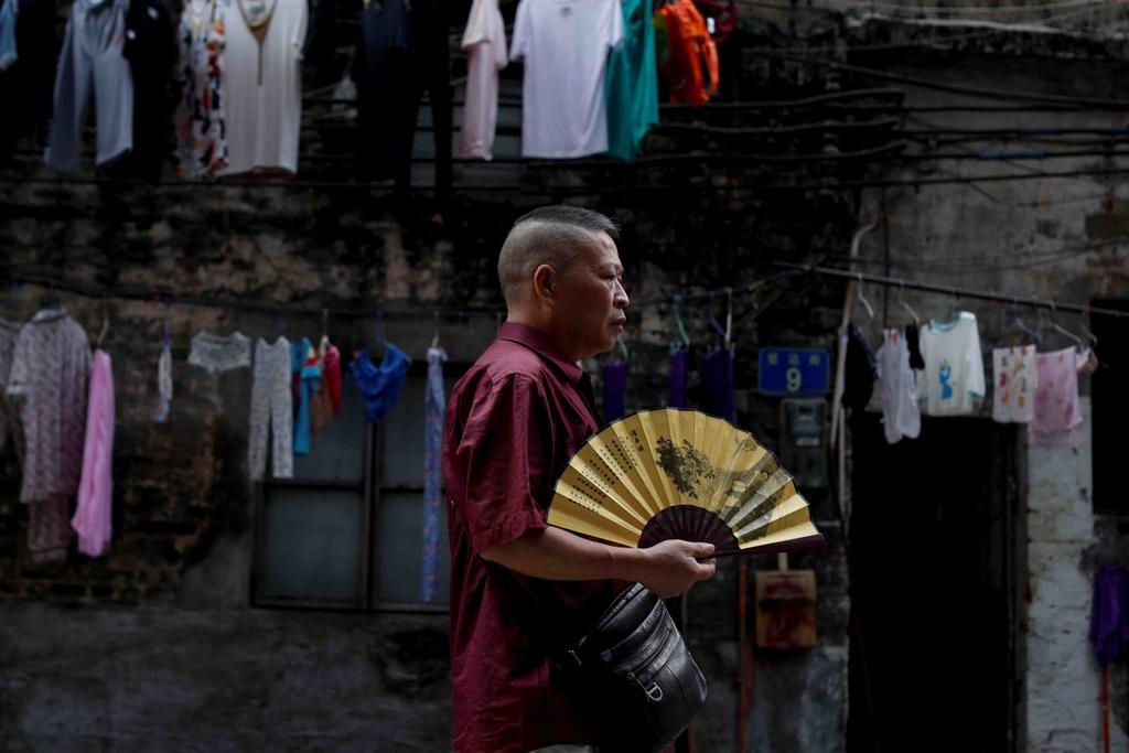 Tiem massage truyen thong, lang do thi trong long Quang Chau hinh anh 8