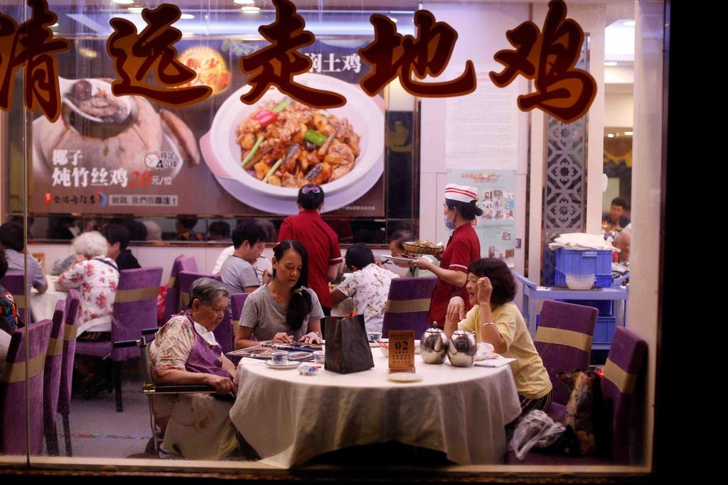 Tiem massage truyen thong, lang do thi trong long Quang Chau hinh anh 12