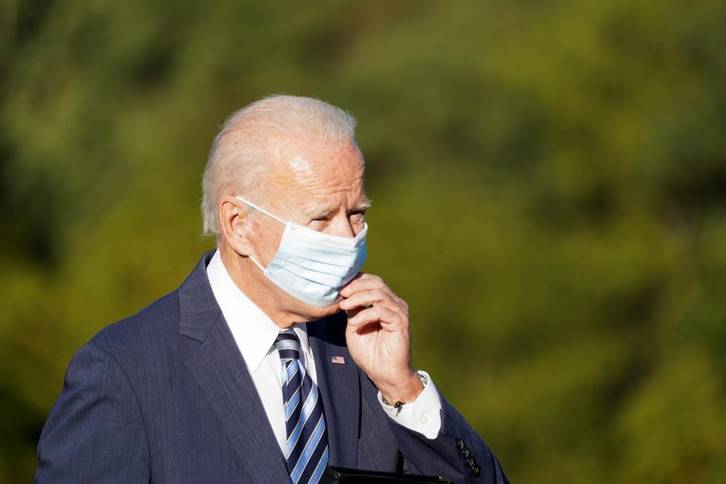 tai sao Biden luon deo khau trang anh 1