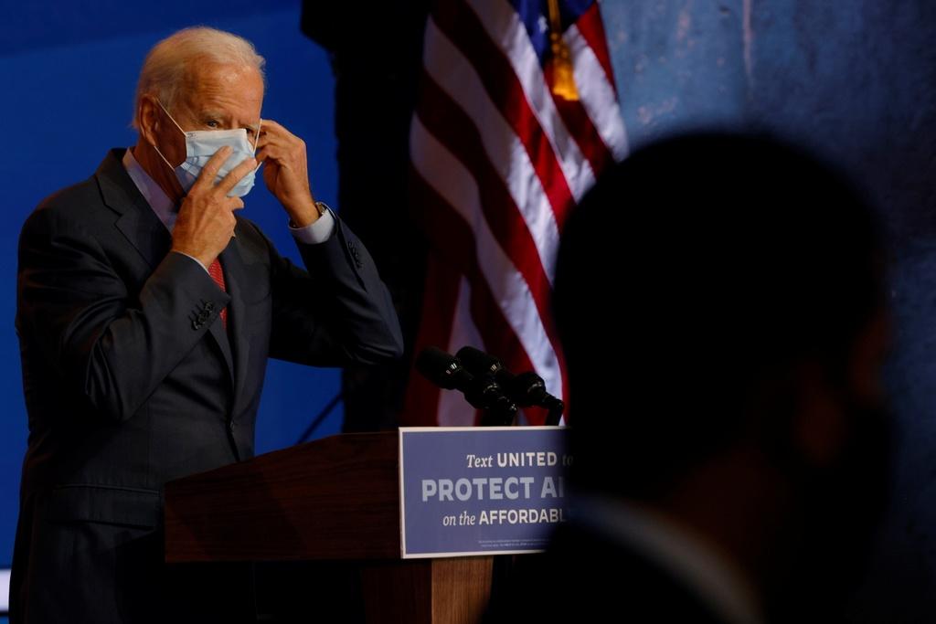 tai sao Biden luon deo khau trang anh 4