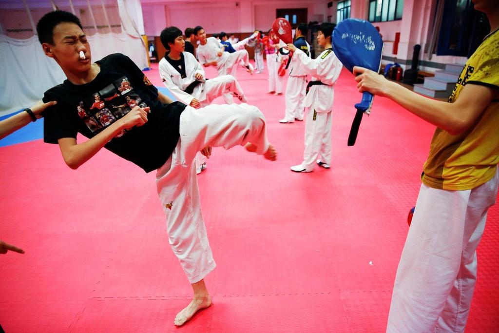 Dang sau nhung tam huy chuong Olympics cua Trung Quoc hinh anh 11