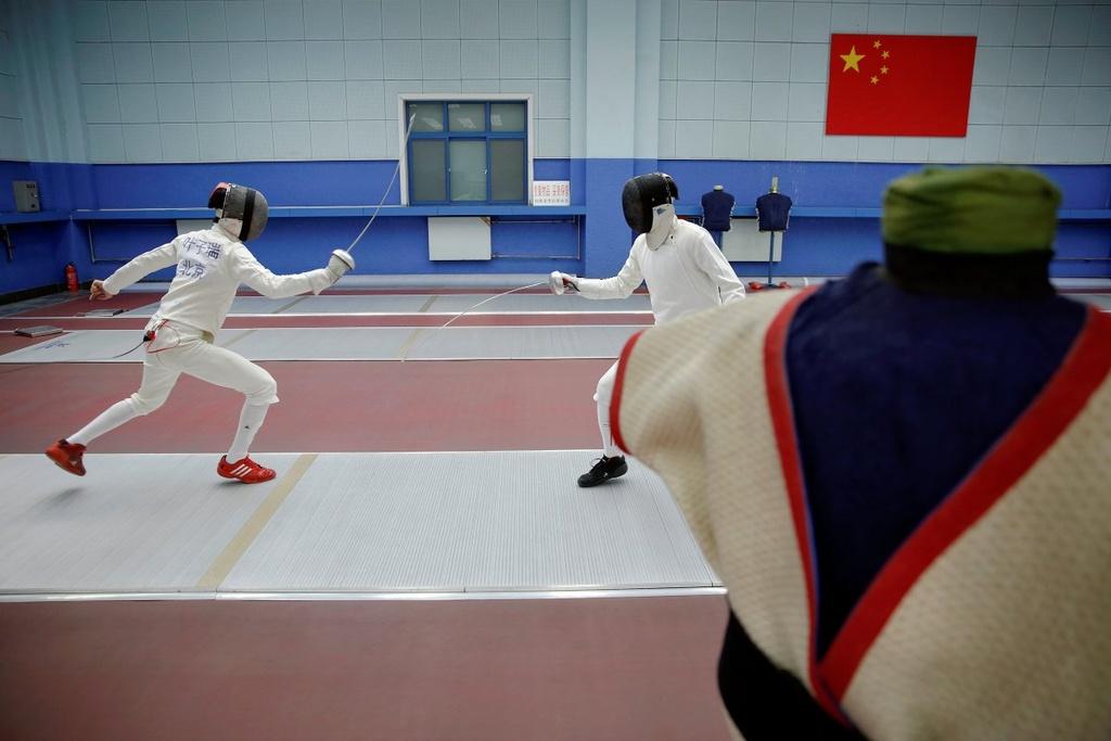 Dang sau nhung tam huy chuong Olympics cua Trung Quoc hinh anh 16