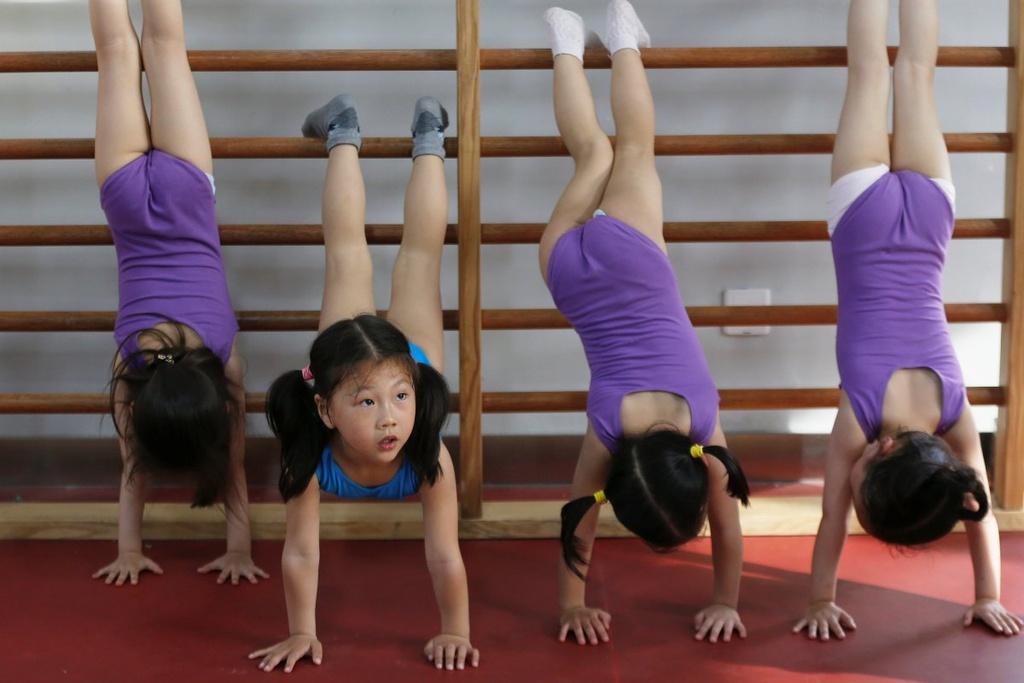 Dang sau nhung tam huy chuong Olympics cua Trung Quoc hinh anh 5