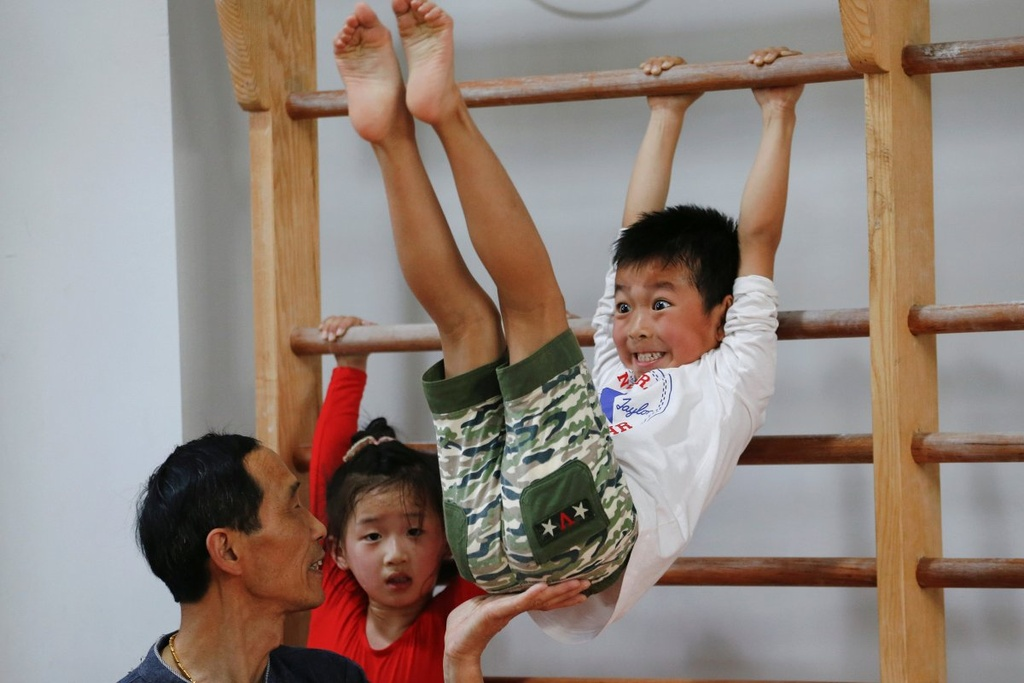Dang sau nhung tam huy chuong Olympics cua Trung Quoc hinh anh 7