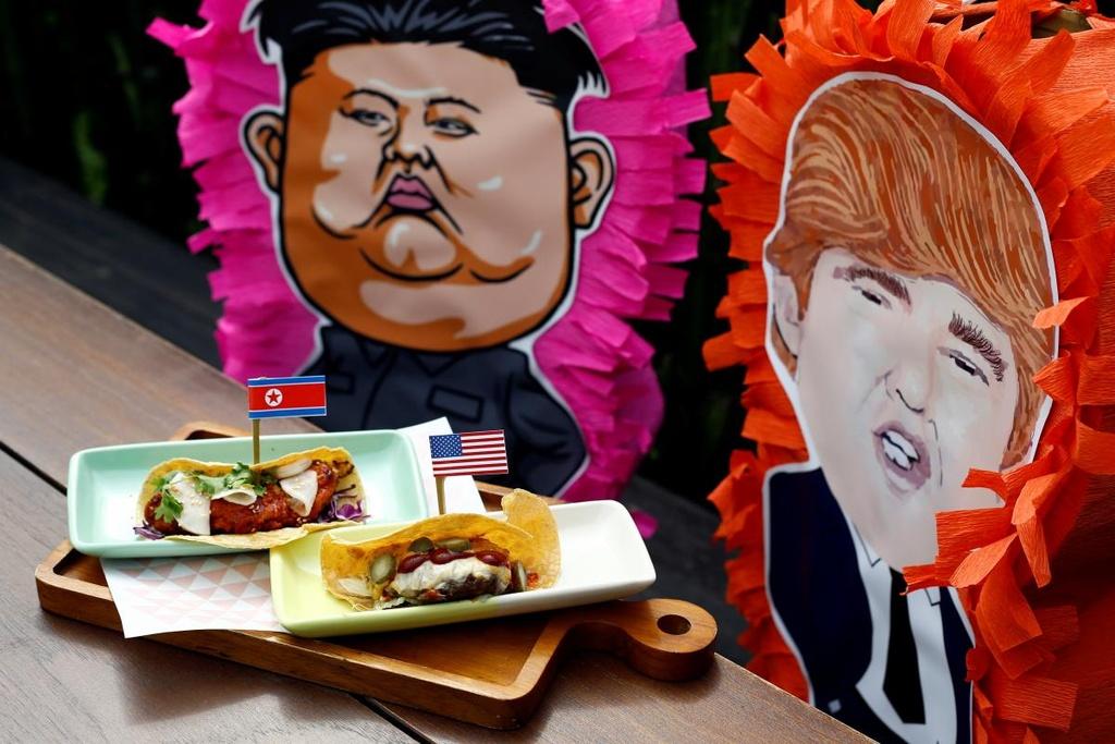 Nha hang Singapore tranh thu an theo thuong dinh Trump - Kim hinh anh 1