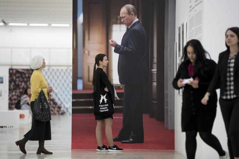 Hinh anh Tong thong Putin la bieu tuong trong cuoc song o Nga hinh anh 2