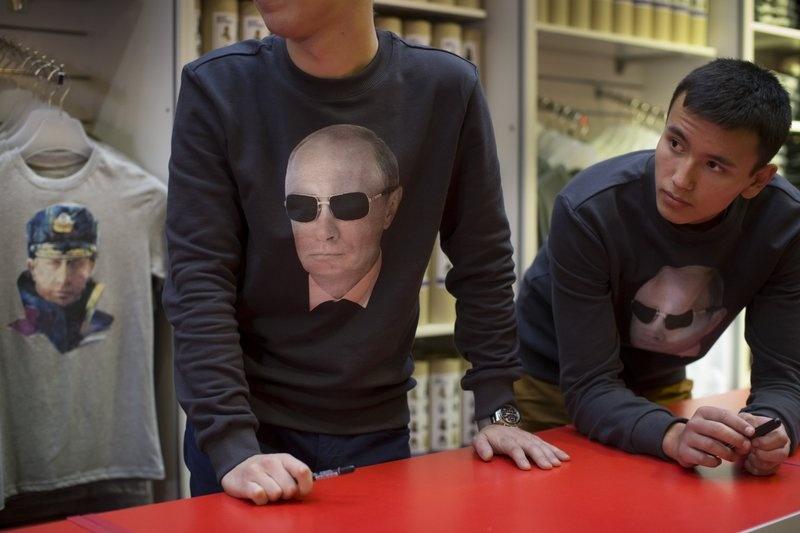 Hinh anh Tong thong Putin la bieu tuong trong cuoc song o Nga hinh anh 4