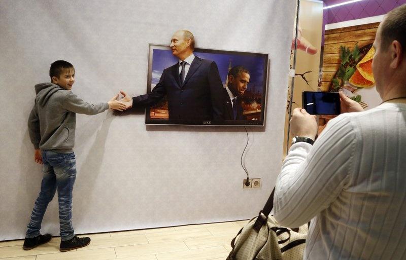 Hinh anh Tong thong Putin la bieu tuong trong cuoc song o Nga hinh anh 5