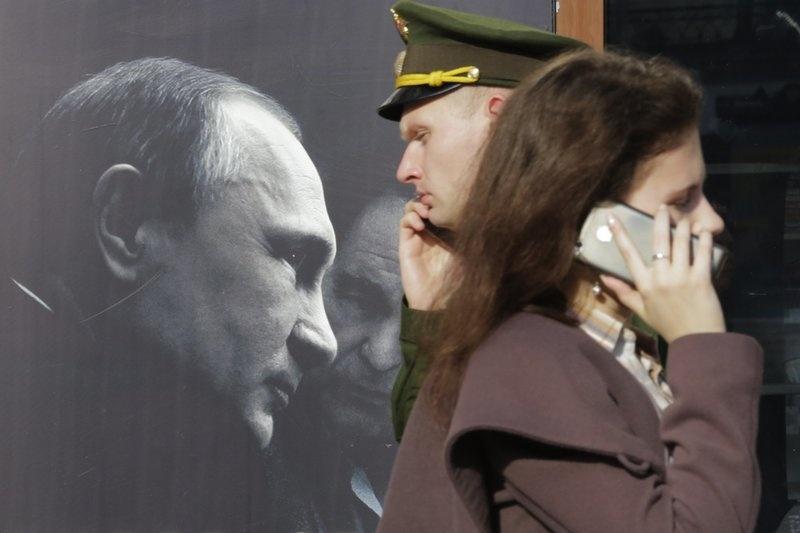 Hinh anh Tong thong Putin la bieu tuong trong cuoc song o Nga hinh anh 6