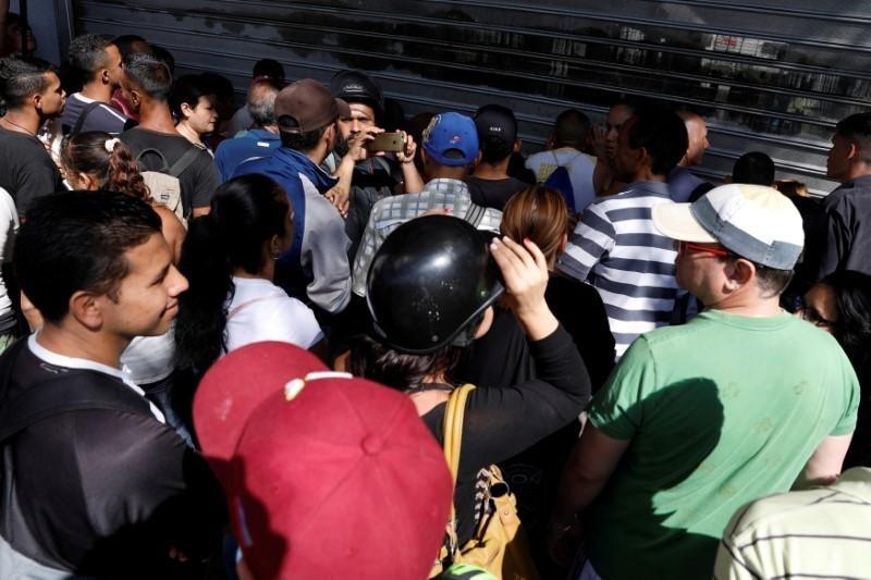 Lam phat o Venezuela: Dung bao tai thay cho vi, can tien thay vi dem hinh anh 2