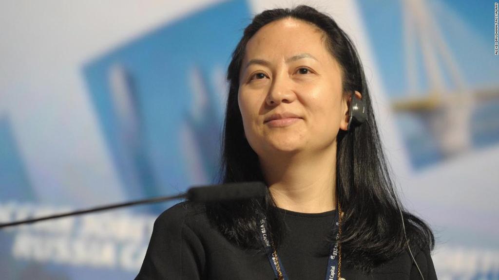 CFO Huawei vua bi bat: Tu tram anh the phiet den quan co My - Trung hinh anh 1