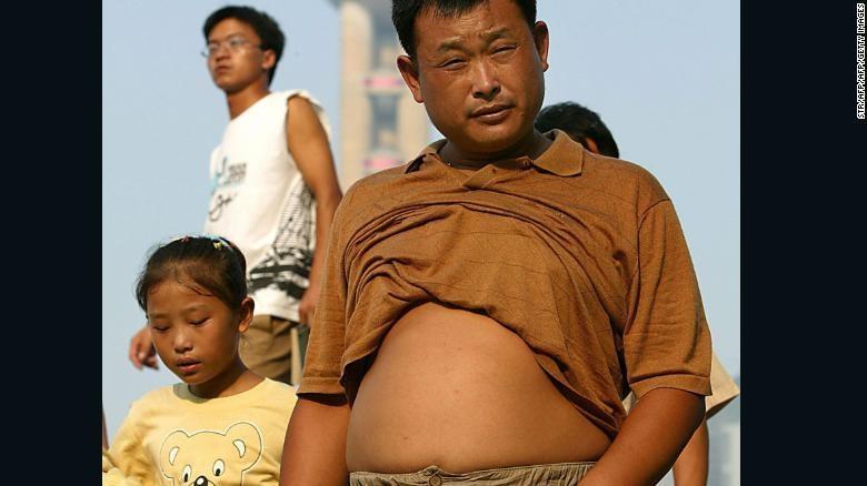 'Bikini Bac Kinh' ngap pho o Trung Quoc, chong choi cai nong mua he hinh anh 10