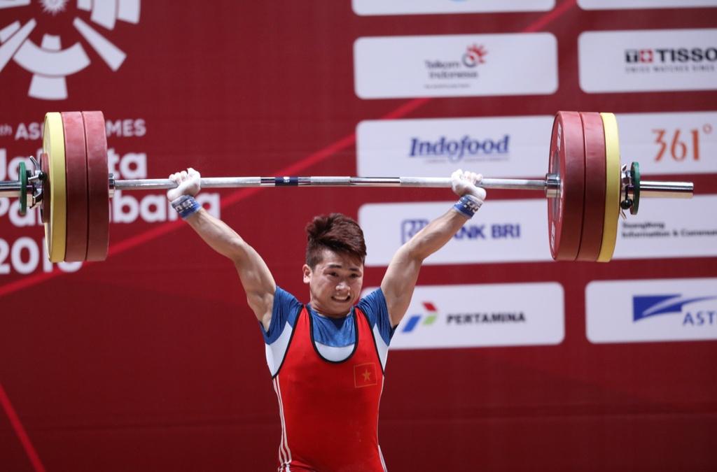 Trinh Van Vinh - nguoi mang y chi thep quyet san vang Olympic hinh anh 1