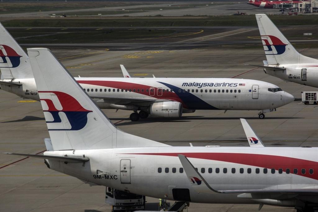Thai Airways, Malaysian Airlines lao dao vi hang khong gia re hinh anh 1