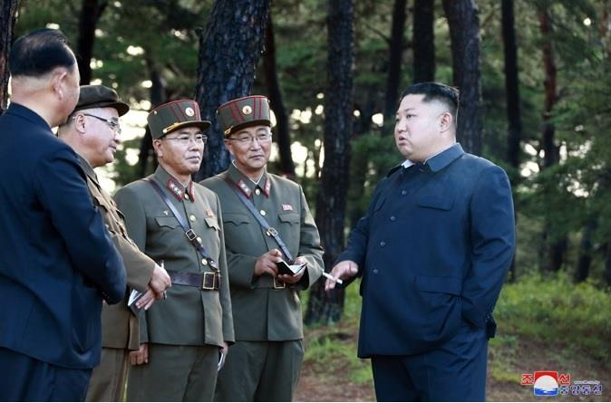 Ong Kim Jong Un hai long ve ket qua thu ten lua hinh anh 6