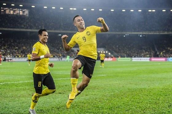 Doi hinh tung giup Malaysia vo dich AFF Cup 2010 gio o dau? hinh anh 11