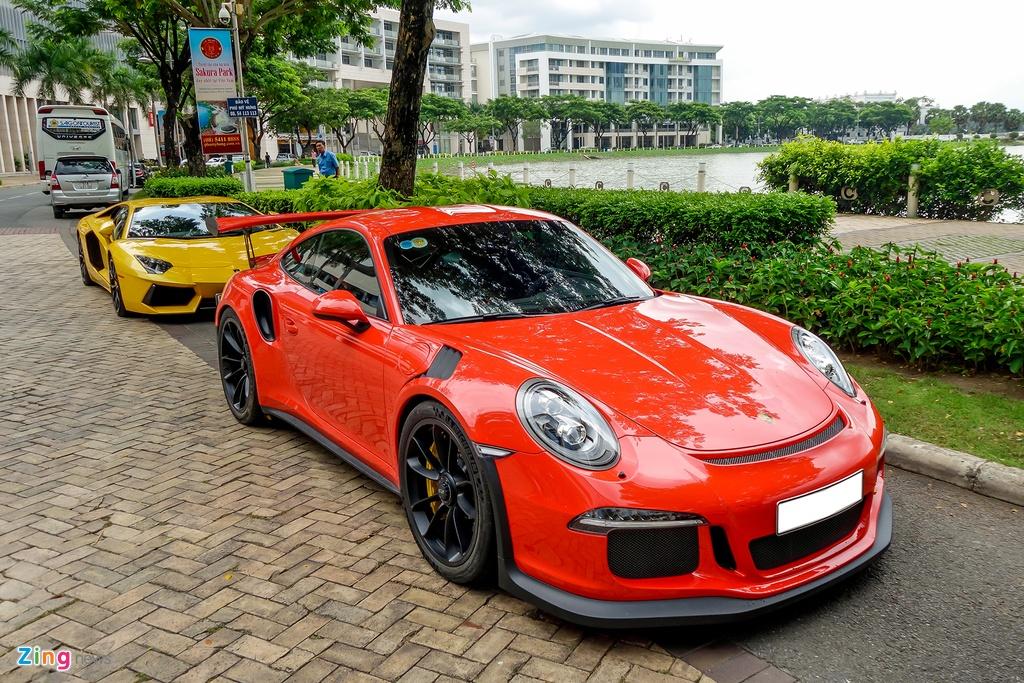 Cuong Do La tu tay rua sieu xe Porsche 911 GT3 moi tau hinh anh 1