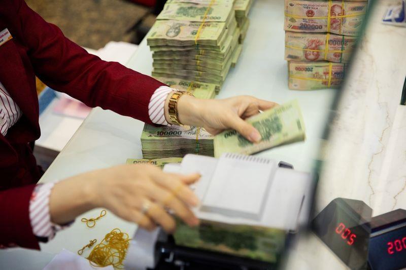 Bloomberg: Di mua nha, nguoi Viet Nam van cam theo vang va tien mat hinh anh 1