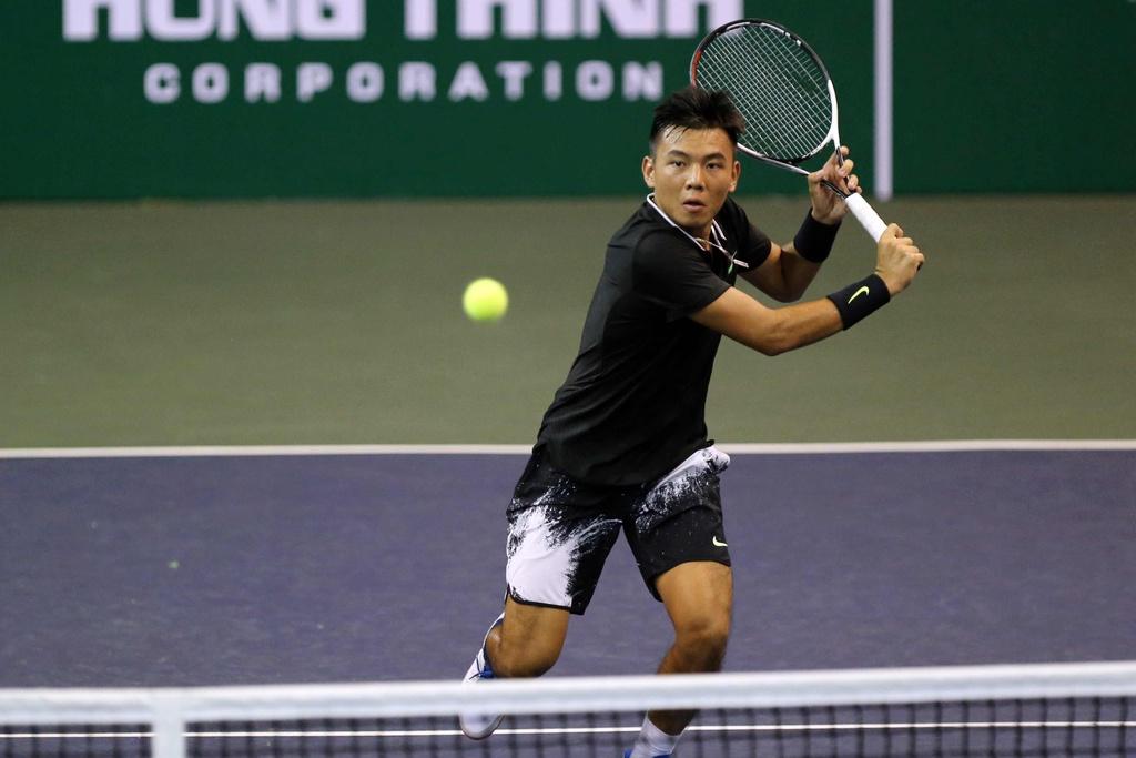 Ly Hoang Nam: Tu cau be danh tennis luc ngu mo den tay vot so 1 DNA hinh anh 1