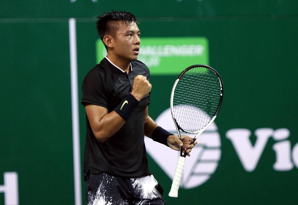 Ly Hoang Nam: Tu cau be danh tennis luc ngu mo den tay vot so 1 DNA hinh anh 2