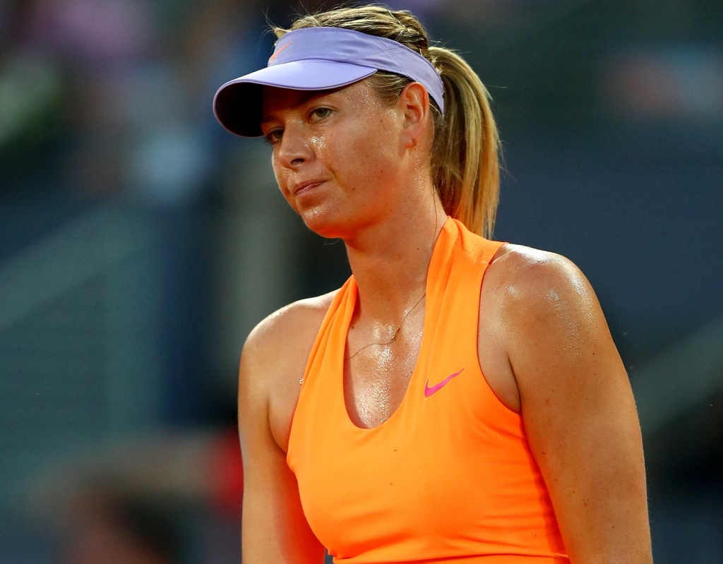Sharapova that bai trong cuoc chien voi Bouchard hinh anh 1