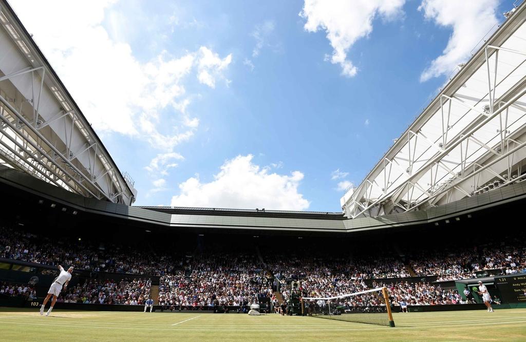 Murray chia tay Wimbledon anh 1