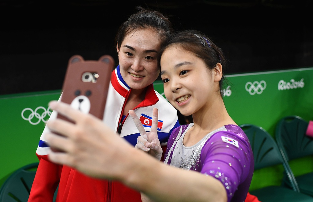 Olympics: Nhung khoanh khac ngot ngao trong quan he Han - Trieu hinh anh 1