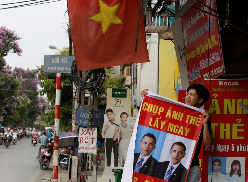 Tong thong Obama roi Washington, len duong toi Viet Nam hinh anh 8