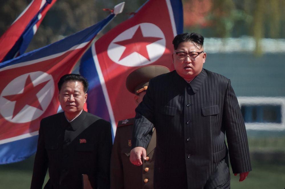Phot lo Trung Quoc, Kim Jong Un doi dau truc tiep TT Trump hinh anh 3