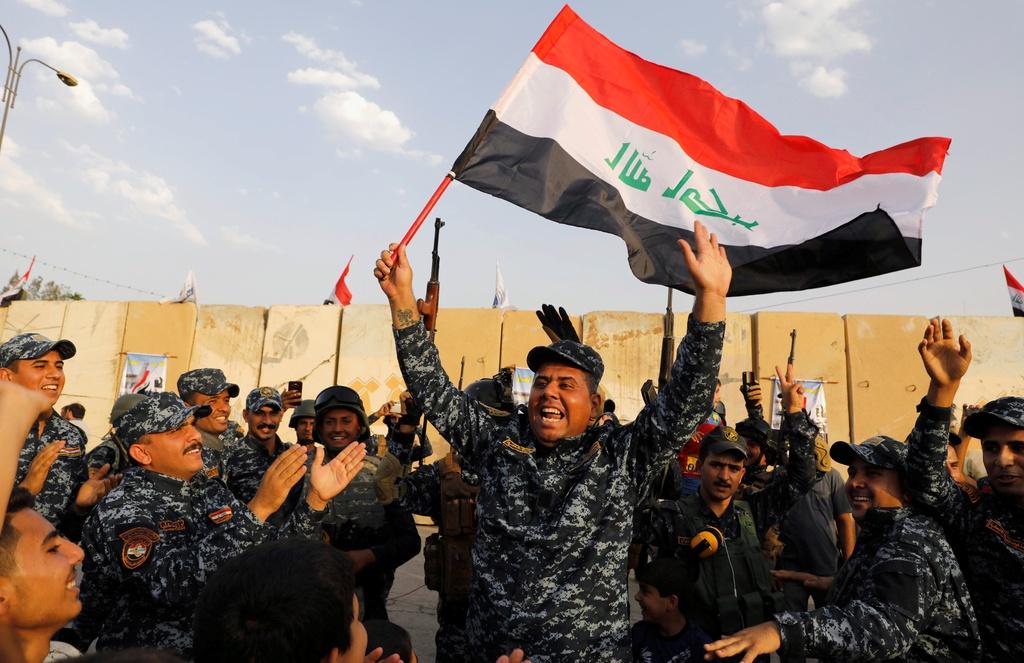 Phien quan IS dai bai, Iraq dieu binh mung toan thang hinh anh 2