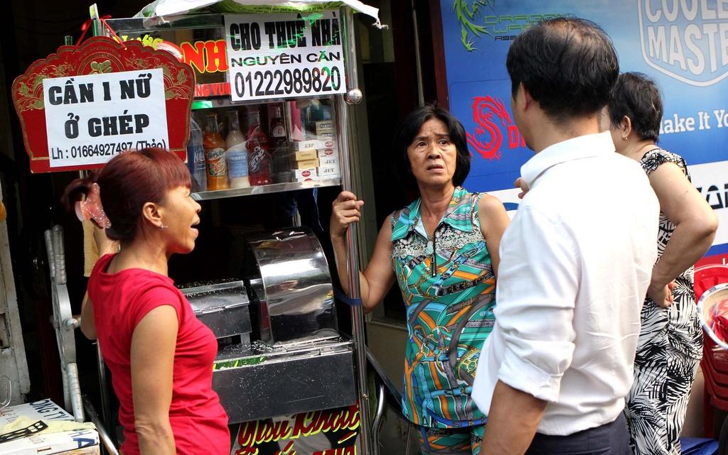 Chu tich phuong Ben Thanh go cua nhac nho tung ho dan lan chiem via he hinh anh 7