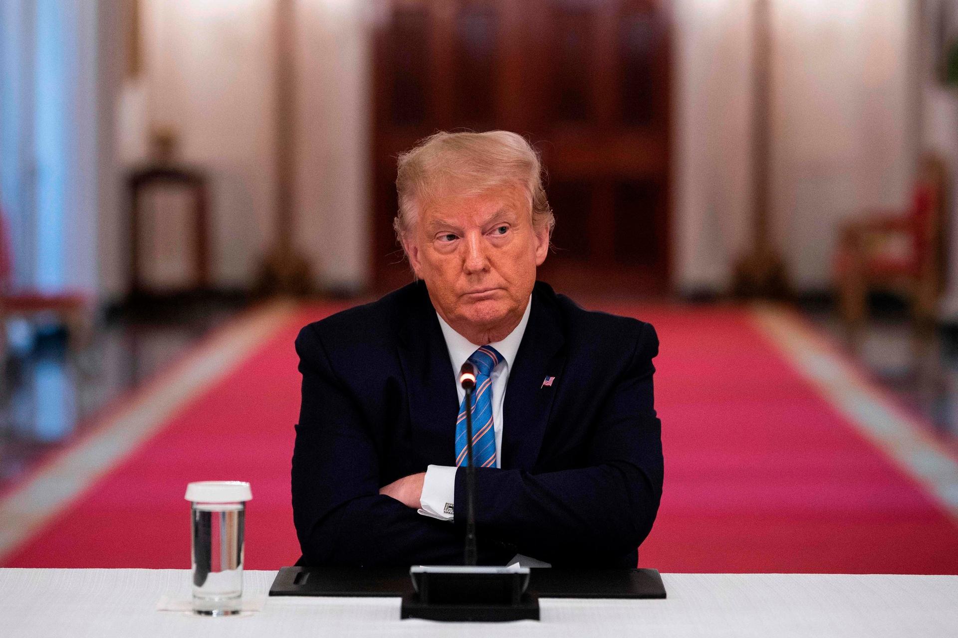 Trump bi cong khai thue anh 1