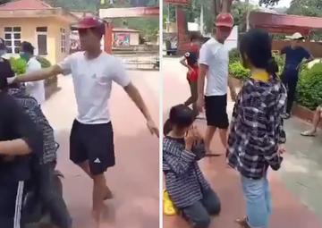 Nam thanh niên túm tóc, bắt nữ sinh quỳ gối xin lỗi em gái giữa sân trường. Ảnh cắt từ clip trên Facebook.